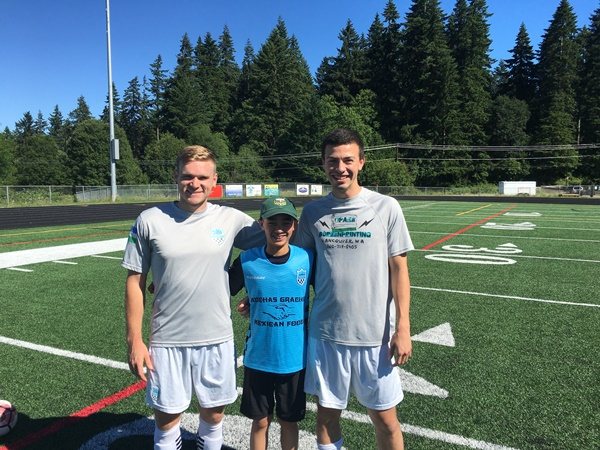 BJ Romac and Jake Young with super fan Kysho Barnhill.